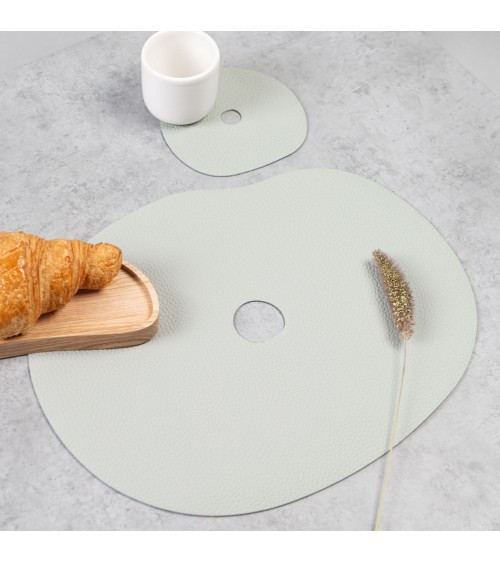 Light grey natural leather table placemats and coasters.